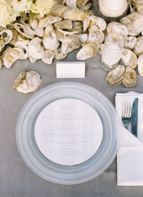 oysters and frosted glass chargers will perfectly highlight your wedding theme