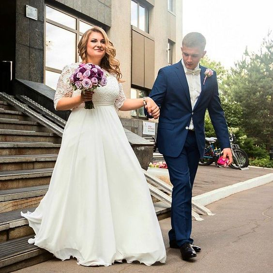 lace bodice wedding dress with long sleeves and a chiffon skirt
