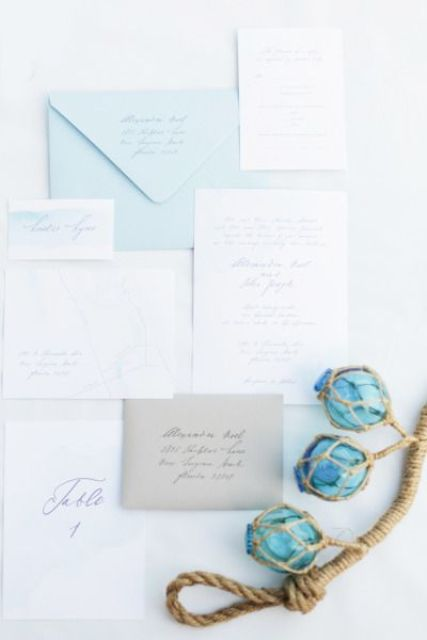 light blue, white and taupe wedding stationary inspired by seaglass