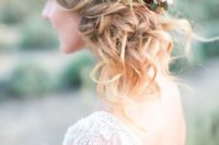 18 side swept updo with succulents and tiny flowers