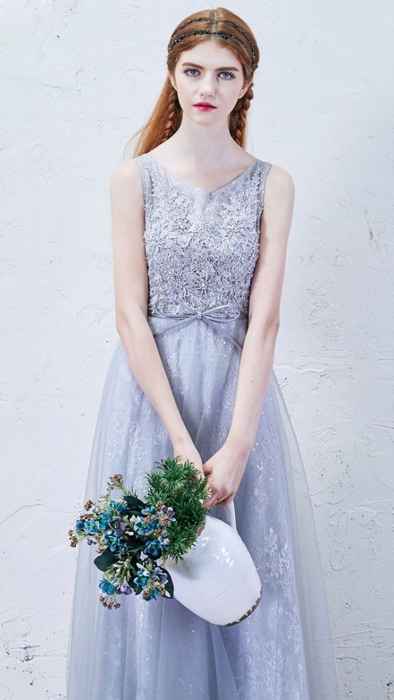 lavender sleeveless wedding dress with a lace applique bodice and a bow on the waist