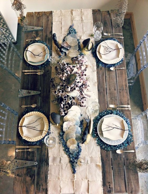 moody ocean-inspired wedding table decorated with real shells and sea creatures
