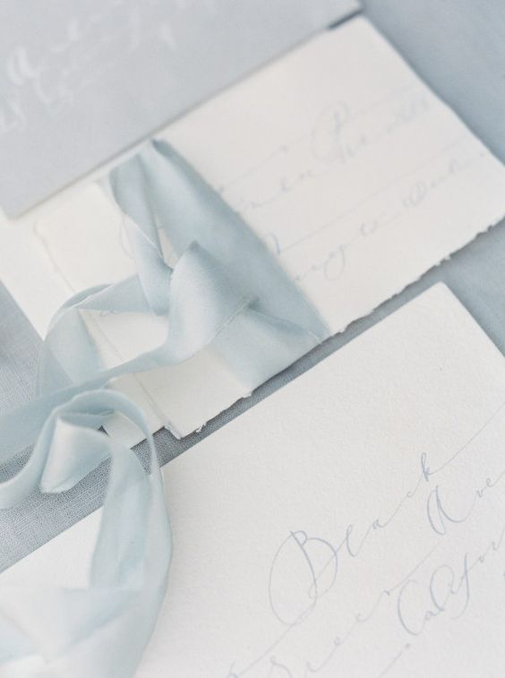 neutral wedding invitations with light blue ribbon