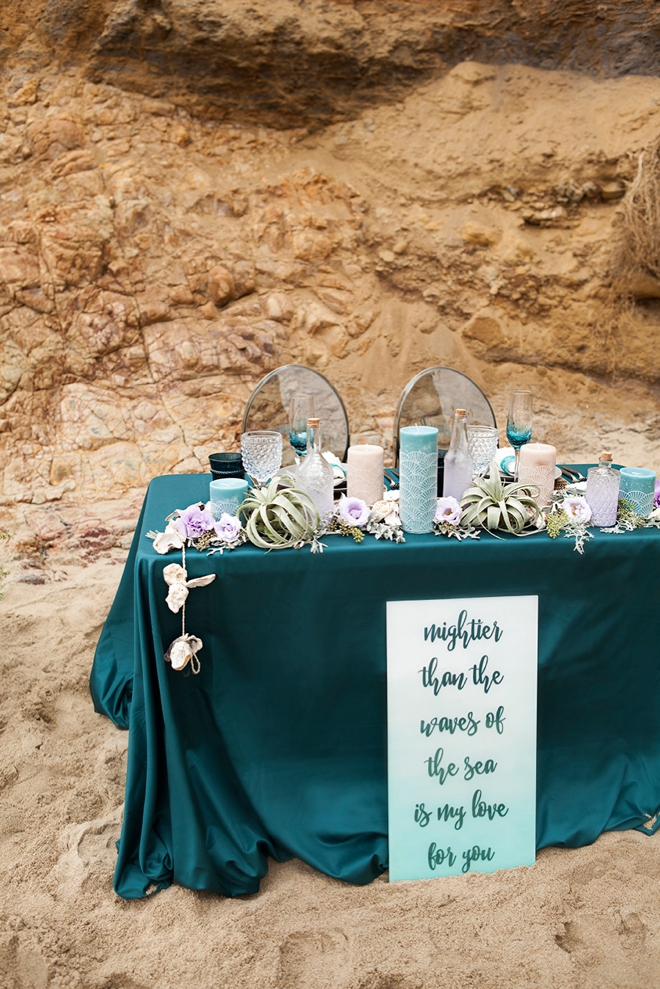 beautiful sweetheart table decor in teal and turquoise shades, with shells and air plants