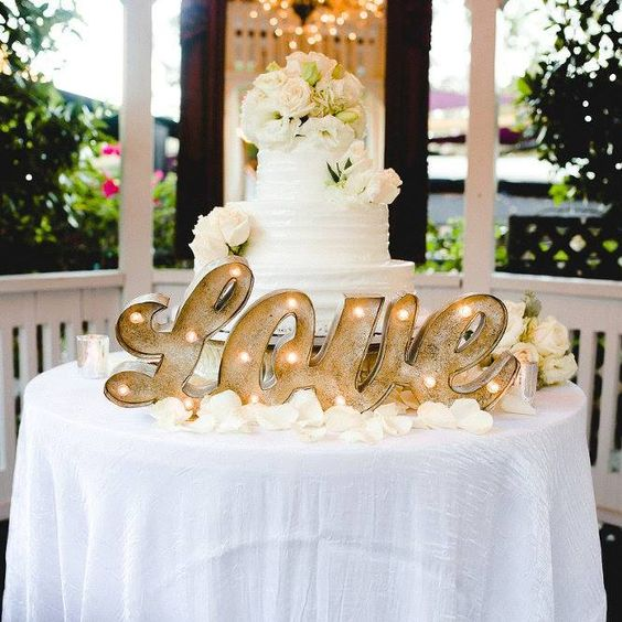 let a marquee LOVE sign light up a cake table and make it the focal point of the reception