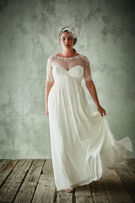 sheer neckline wedding dress with short sleeves and a flowy skirt