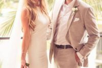 21 a beige suit with a white shirt and a floral boutonniere
