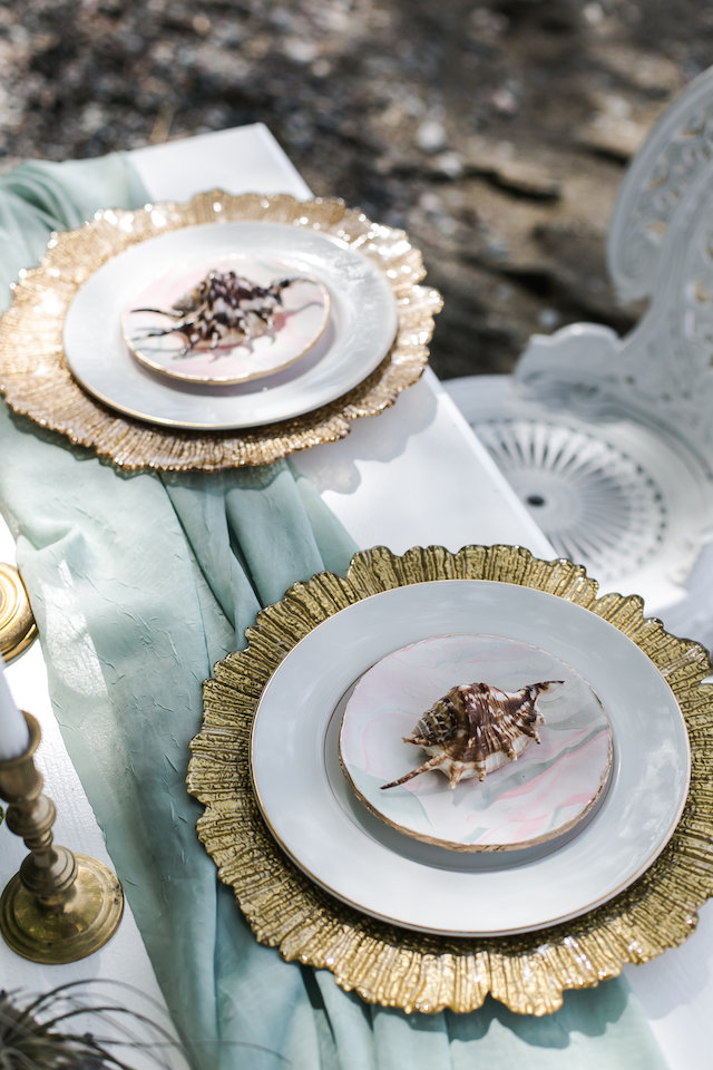 gold platters and shells for each place setting