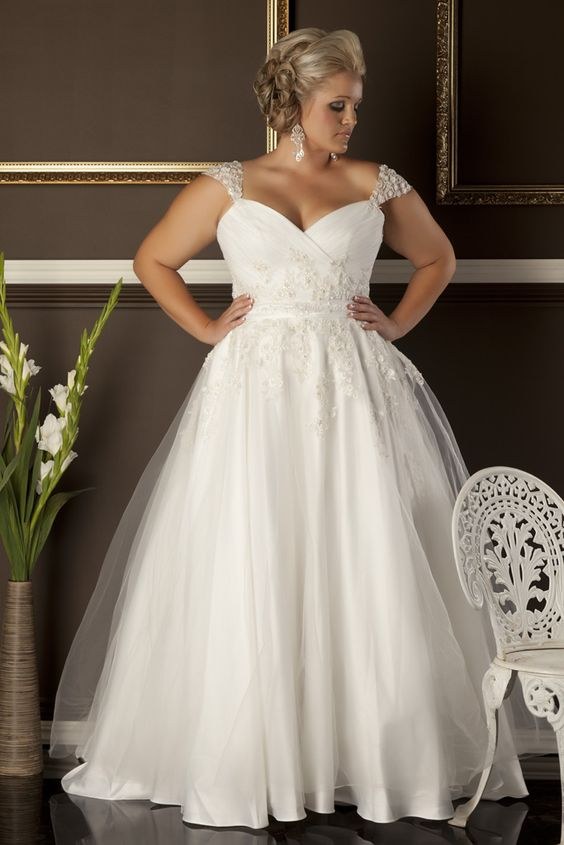 plus-size bejeweled wedding dress with cap sleeves aand a sweetheart neckline