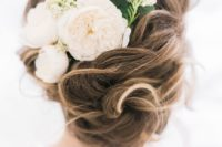 21 twisted wedding updo with a fresh flower comb and leaves