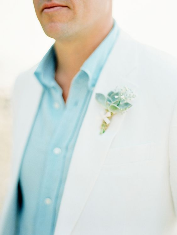 a cream-colored suit, a light blue shirt and a succulent boutonniere