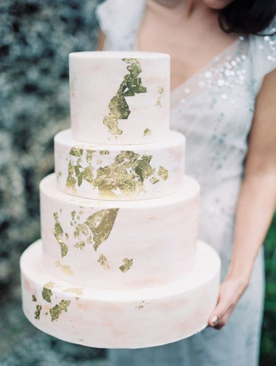 blush marble wedding cake with gold leaf accents