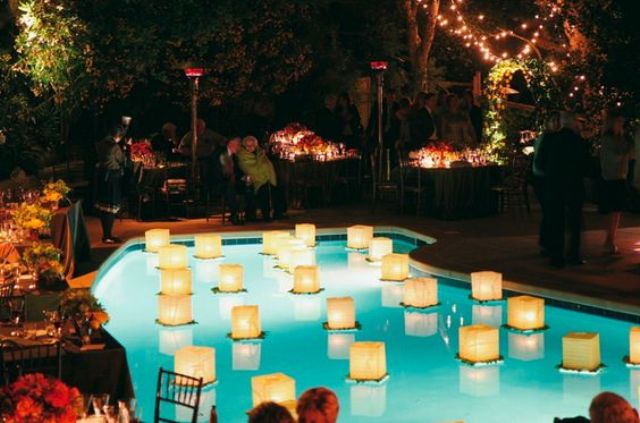 Floating Lanterns In The Pool Will Light Up Your Reception Even More