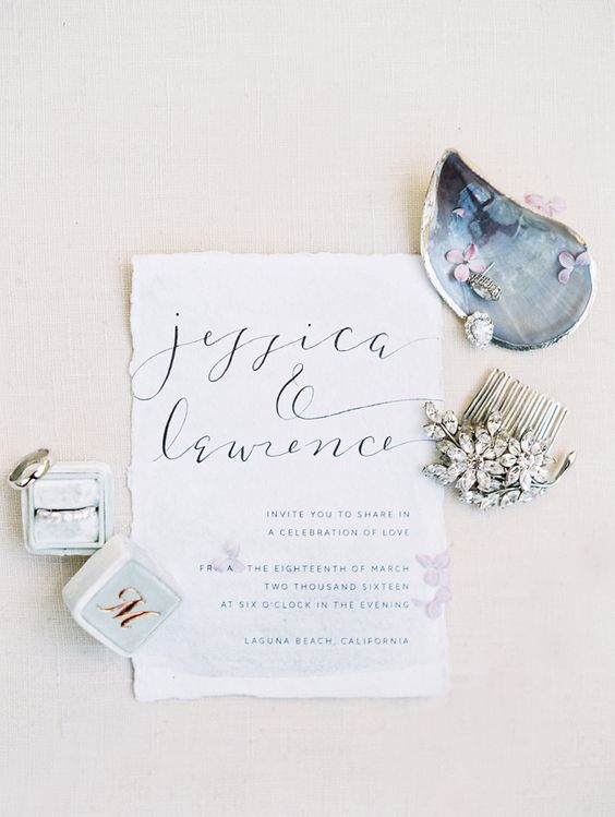neutral coastal invitations with blue calligraphy