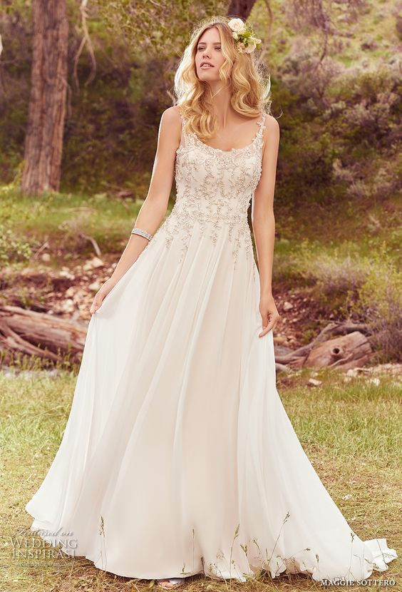 thin strap embellished bodice wedding dress with a flowy skirt