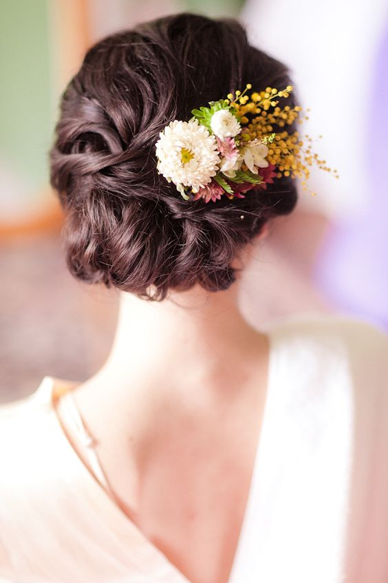 twisted updo with fresh flowers on the side