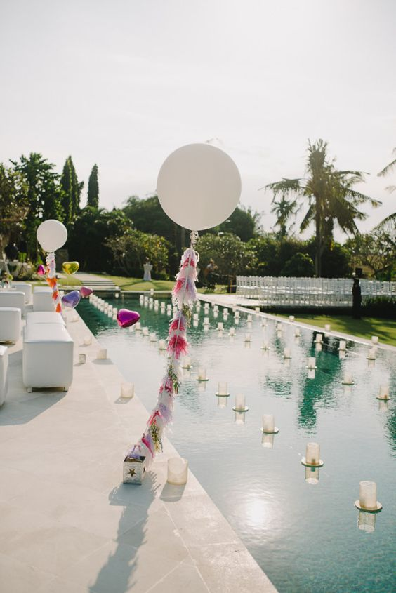 candles, balloons and tassels for decorating the pool