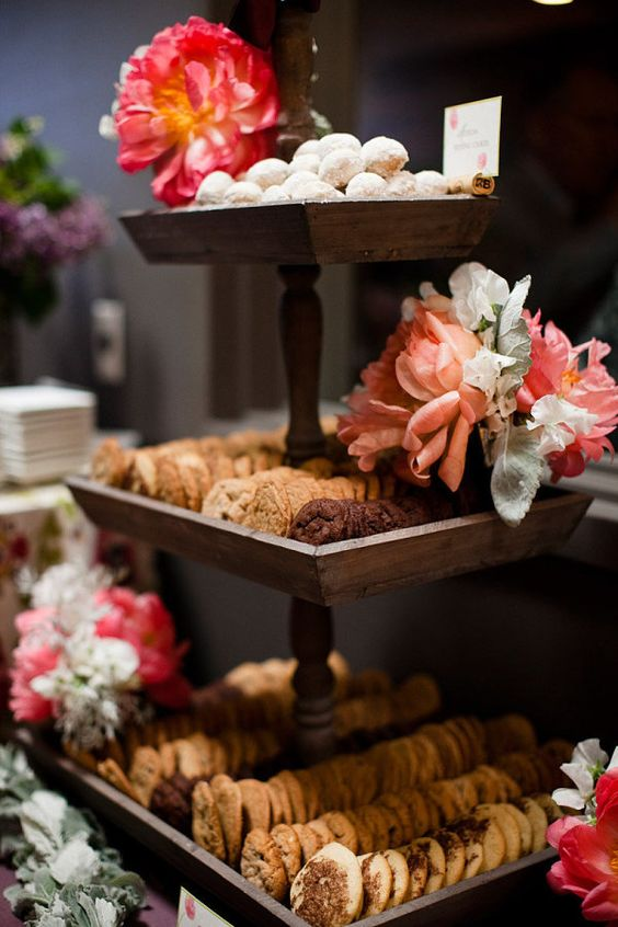 rustic cookie stand decorated with fresh blooms