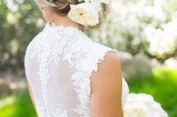 23 side swept braided updo with big white blooms