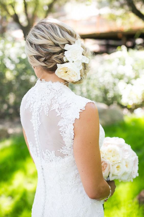 side swept braided updo with big white blooms
