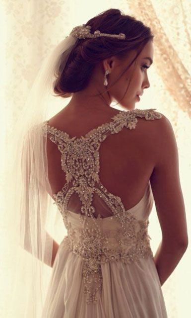 stunning lace and jeweled racerback of your wedding dress will make everyone look at you