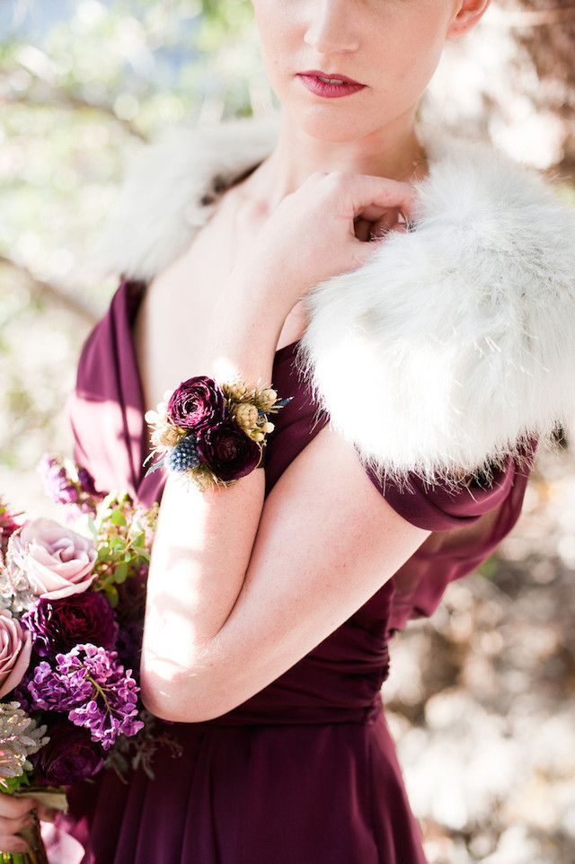 moody floral corsage that matches the dress
