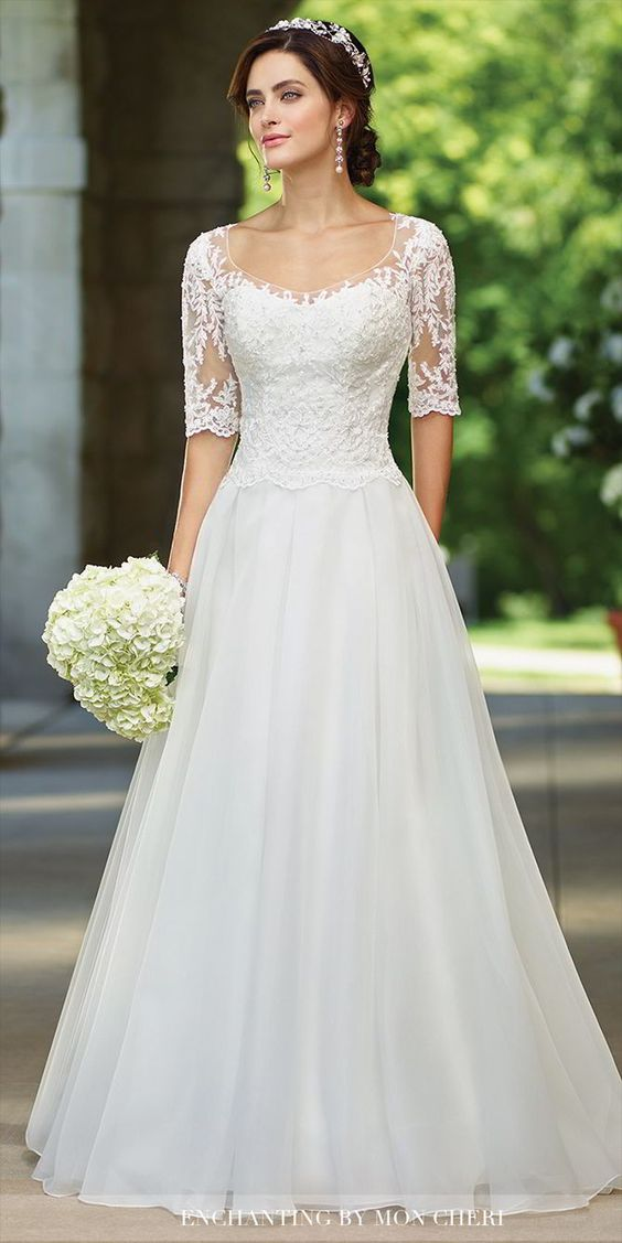organza full A-line gown with illusion lace three-quarter length sleeves and scoop neckline