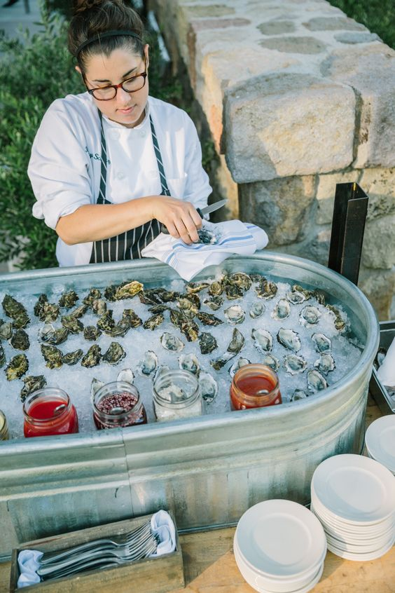 outdoor rustic oyster bar with various sauces