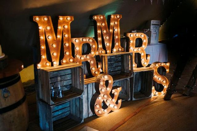 lit up marquee Mr&Mrs letters on crates for wedding venue decor