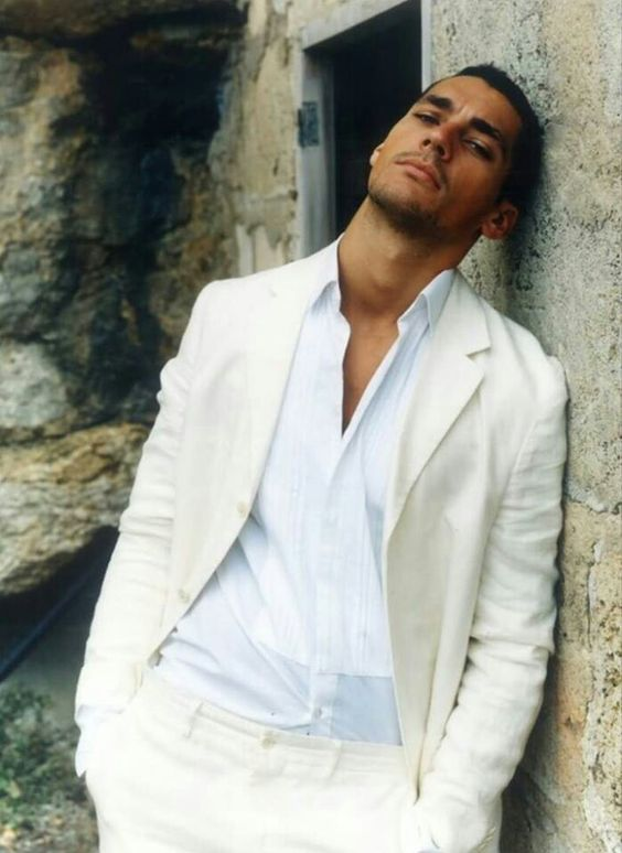 an ivory suit with a white shirt for an effortless chic look