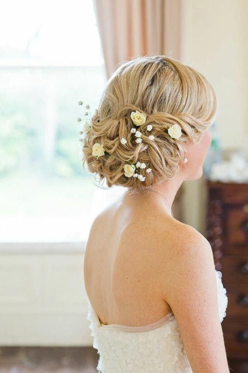 low twisted bridal updo with baby's breath and garden roses