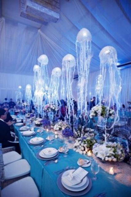 under the sea wedding motif with hanging jellyfish table decorations