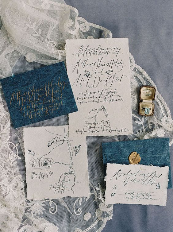 chic ivory and teal printed wedding stationary in vintage style