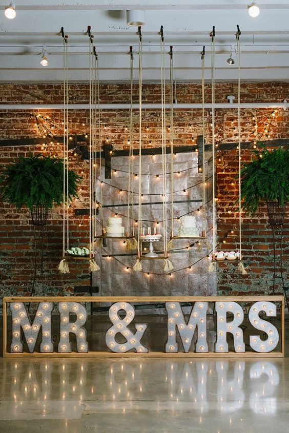 industrial wedding venue with framed Mr&Mrs marquee letters