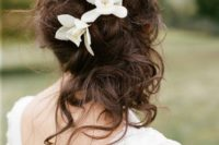 27 messy curly wedding half updo with tropical flowers