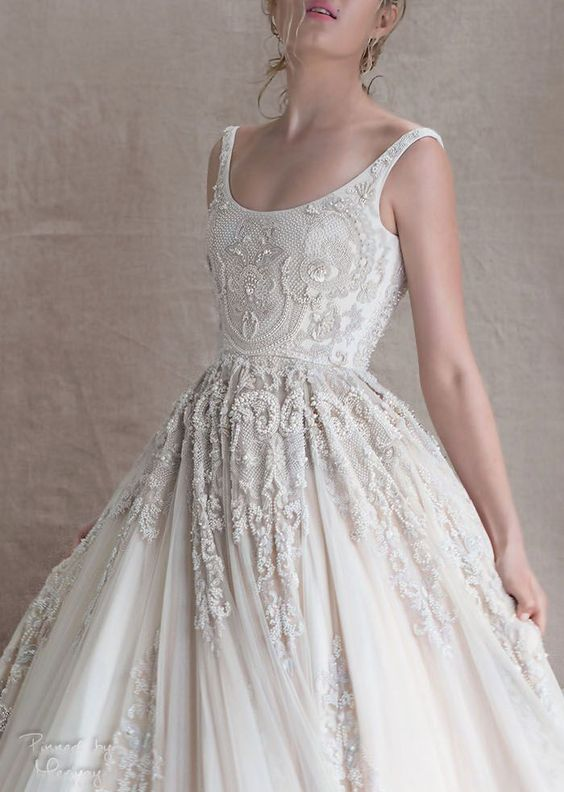 thin straps, a heavily embellished bodice with a scoop neck, A-line wedding dress