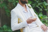 28 a white suit and shirt, a tropical flower boutonniere and a perfectly groomed beard