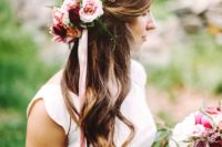 28 curly half updo with fresh flowers and ribbon