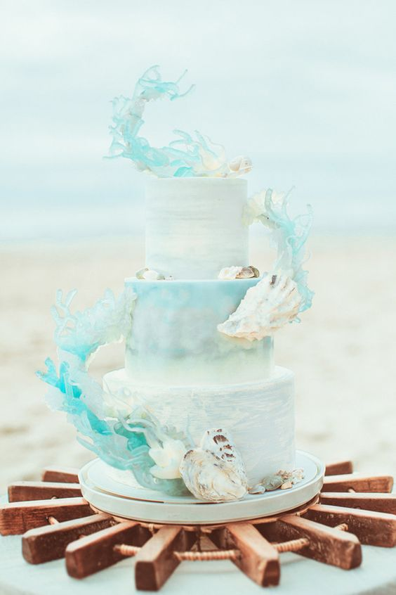 watercolor light blue wedding cake with sirl decor and shells
