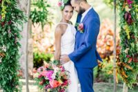29 bold blue groom's suit and a colorful floral boutonniere