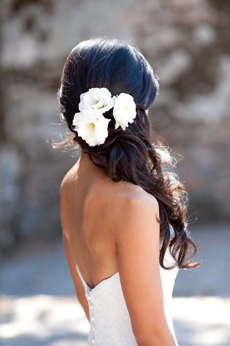 curly half updo with fresh white blooms