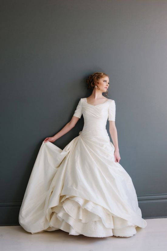 draped ivory wedding ballgown with short sleeves