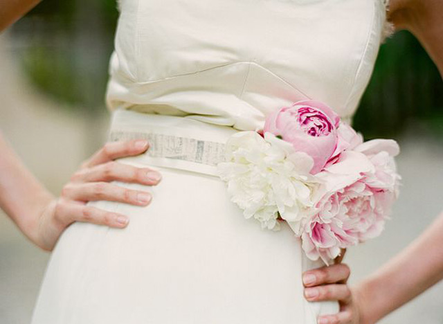 embellish your wedding sash with cool fresh blooms