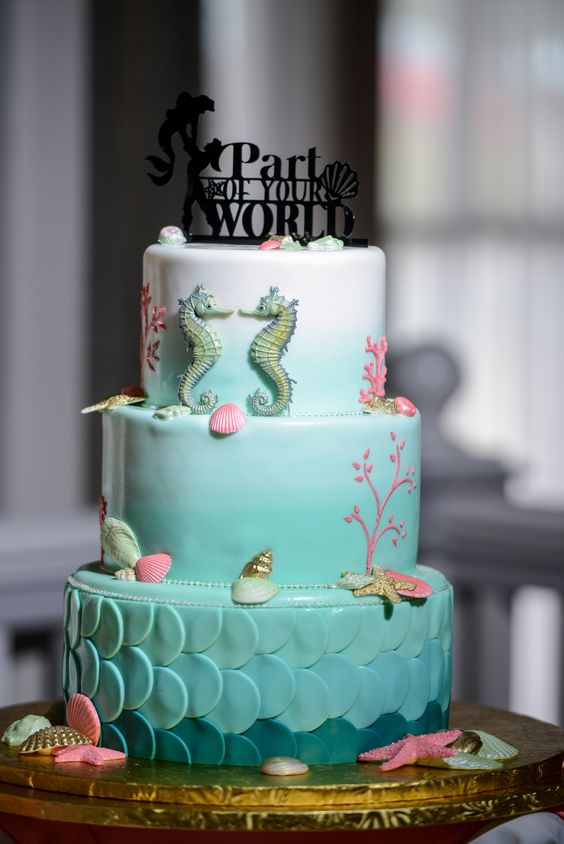 Ariel-inspired wedding cake with proper decor