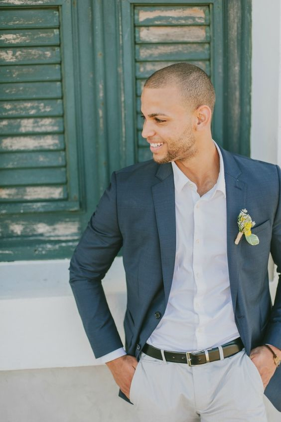 grey pants, a white shirt and a navy jacket, a bold boutonniere to spruce it up