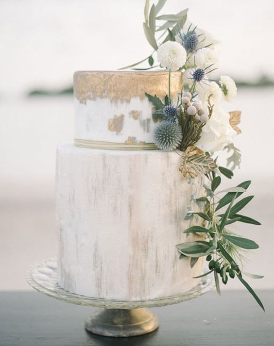 marble wedding cake with gold leaf strokes, flowers and thistle