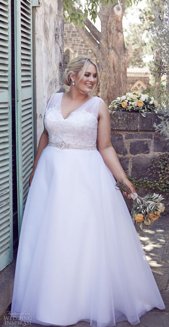 wide strap wedding dress with a lace bodice and a bejeweled sash