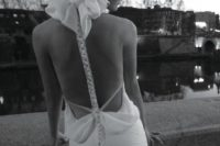 31 couture wedding dress with a mermaid silhouette and a racerback with a big bow