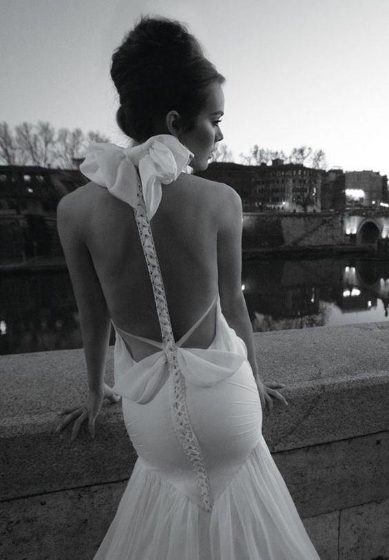 couture wedding dress with a mermaid silhouette and a racerback with a big bow