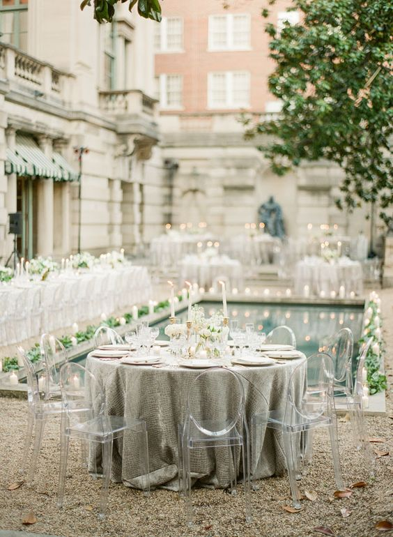 neutral wedding reception with greenery and candles looks chic